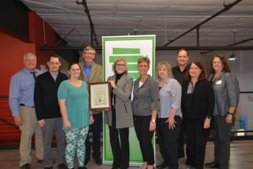 """President and CEO, Kari Yunker and the """"Yunker Green Team"""" receive state certification from the WI DNR for their sustainability efforts."""