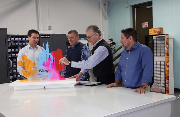From the left, Christopher Dillon, VP of manufacturing, retail marketing solutions; Glenn Brown, VP creative director; Mike Lane, CEO; and Dave McConnon, VP of manufacturing, Label and Card, take a look at a display that Meyers produced for Disney.