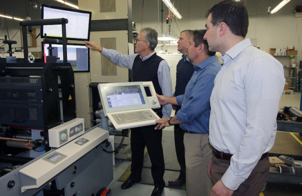 From the left, Mike Lane, CEO; Glenn Brown, VP creative director; Dave McConnon, VP of manufacturing, Label and Card; and Christopher Dillon, VP of manufacturing, retail marketing solutions, operate the MPS EF SYMJET hybrid press from Domino. Meyers was the first company in North America to install the press.