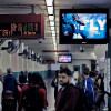 A digital ad for the Philadelphia Eagles, sits just above the platform of Philadelphia's busy Suburban Station.