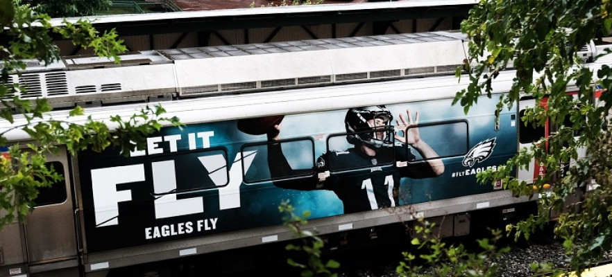 As part of the Eagles campaign, Intersection created full wraps and ultra-super kings on buses and trains, like this one here.