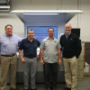 From left to right: Bob Stone, production manager; Jose Lopez, pressroom manager; Patrick Gates, press operator; and Ryan Bush, VP, stand next to Master Print's new Speedmaster CX 102 from Heidelberg.