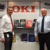 Arthur Verwey, senior marketing manager at OKI Data Americas, visited John McGuire to make sure the Sponsor of the Month wall looked good and included the latest samples from OKI C900 printers.