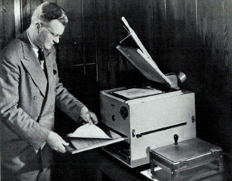 Chester Carlson, inventor, with the first commercial Xerox machine. Note the hotplate used to fuse the toner to the paper. Image taken from Fortune magazine 1949. | Credit: Fortune