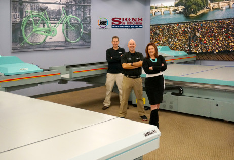 Mary Lou Goehrung, president, with her sons Glenn, far left, VP and COO, and Scott, VP and CTO, alongside their two Fujifilm Acuity F presses at their Rockville, Md., facility.