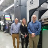 Short-Run Digital Success-Paul DeSantis, Carlyle Bauer and Jeff Stoltzfus, of ANRO Inc., stand with one of the two HP PageWide Web Press T370 color inkjet presses that the company operates.