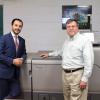 Short-Run Success-Bill Corcoran Jr. (left) and Bill Corcoran pose with the Heidelberg Versafire CV press that has greatly improved short-run production at Corcoran Printing.