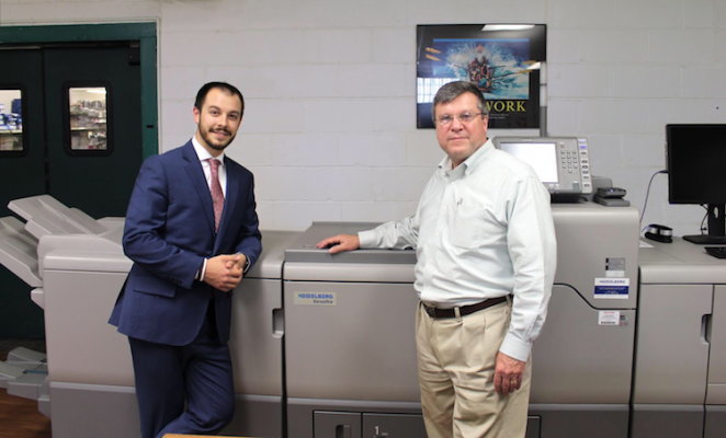 Short-Run Success-Bill Corcoran Jr. (left) and Bill Corcoran pose with the Heidelberg Versafire CV press that has greatly improved short-run production at Corcoran Printing.