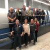 The centerpiece of packaging production at Foremost Graphics Group is a new six-unit, coater-equipped KBA Rapida 106 sheetfed press. Front row, from left: Ron Schmidt; Carrie Bucker; Todd Dykstra; and Sarah DeVries. Back row, on press: Russ Manning; Shannon Kutsche; Randy Rollenhagen; Mark Jensen; Rod Ackerman; Joe Baruta; Rob Steimel; and Clarence Reynolds.
