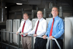 Folding carton production now contributes two-thirds of the revenue at Spectrum Print Communications. Standing, from left, are: Bill Cassese, VP of operations; Mike Rogers, owner; and Mark Mills, VP of sales and marketing.