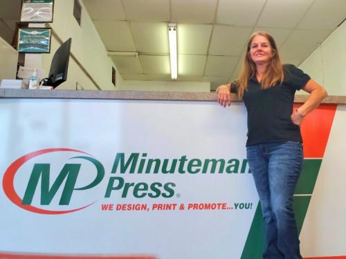 Susan Olsen in her Minuteman Press printing franchise in Leesburg, Fla.