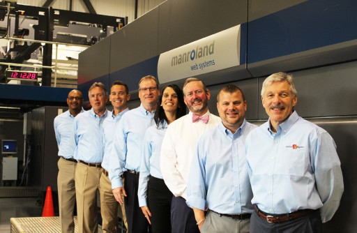 Bob Bradley, VP of sales, Bradford & Bigelow (third from the right), stands with the B&B sales team with the company's new manroland Goss four-color offset web press.