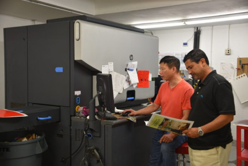 Jerry Deng (left) and Paul Nag check a job coming off the HP Indigo press. Digital and offset capacity work in harmony.