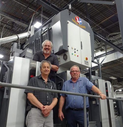 Eagle President and CEO Mike King oversees Colbert Printing Manager, Steve Sifrer (L), and Barney McLin, Colbert Corporate Facilities Manager in the implementation of their Eagle Cold Foil unit, in-line with their Ryobi press.