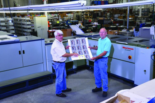 Tom O'Brien (left) and VP of Manufacturing Wayne Renn use a Horizon SmartStacker from Standard Finishing Systems.