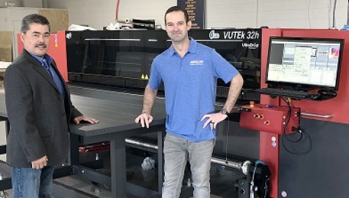 American Graphics' Gene Reynolds, production manager, and Nicholas Hindman of American Graphics' Apparel and Signage Division, with their new EFI VUTEk 32h printer