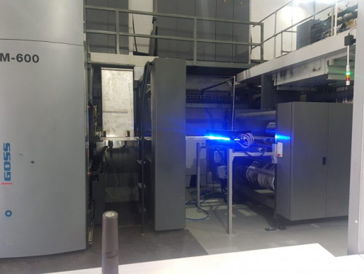Shown is an AMS Spectral UV X-series LED-UV curing unit mounted on a Goss M600 web offset press.