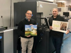 Glenn Schuster and Eric Schuster, with the first prints off their HP Indigo 7900.