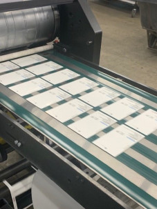 HP PageWide Web Press card printing on Teslin.