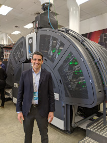 Carles Farre, worldwide director of PageWide Commercial Business at HP, stands with the new PageWide Web Press T250 HD production inkjet press.