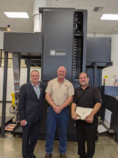 From Left: Scott Michels, VP, global business development, Harris & Bruno; Doug Corbett, global service manager, Harris & Bruno; and Bobby Rahmani, operator for HP, with the newExcelCoat ZRW.