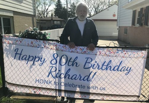 A local sign company created happy birthday signs to set up on my parent's lawn for my dad's birthday.