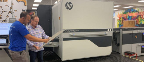 Dave Bennett (right) confers with HP Indigo press operator Adrian Ziminov. Bennett Graphics served as a North American beta site for the new HP Indigo 100K digital press. Trying out new technology before it's widely available gives Bennett a competitive edge.