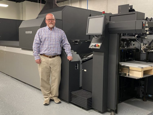 Jamie Brisendine, director of ASB Graphics, stands with the new J Press 750S.