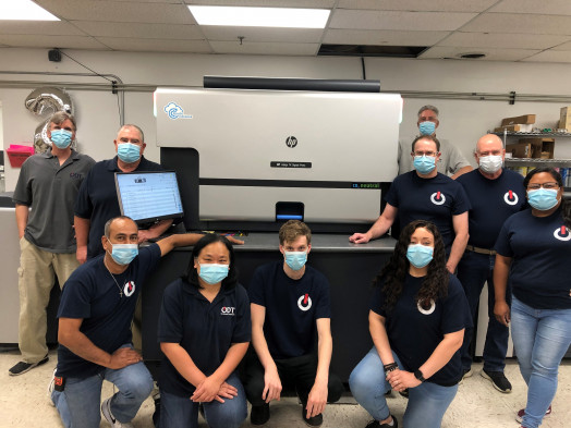 The On Demand Technologies team with the new HP Indigo 7K digital press.