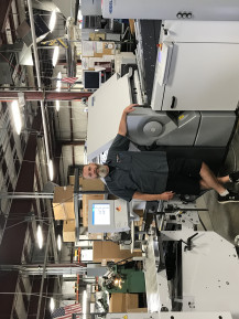 Rob French, bindery manager of Allied Media, stands with the Stahlfolder KH 82.