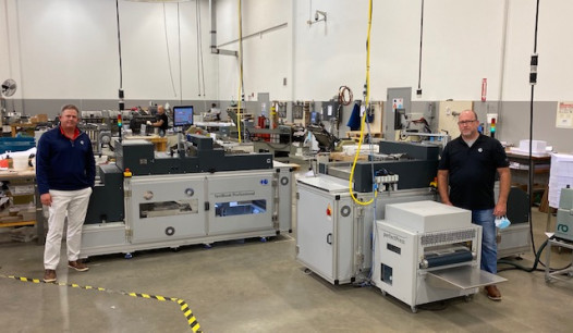 Linemark Partners David Ashton (left) and Steve Bearden with the fastBook Professional machines expanding their layflat book production.