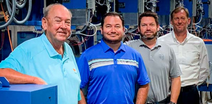 (Left to right) From Foster Printing: Dennis Blackburn, CEO; Tim Blackburn, president; Kris Blackburn, VP of sales; along with Koenig & Bauer sales manager Marcus Schoen; have begun installation on their new Rapida 164 six-color 64-inch press.