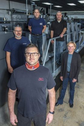 (Front) Randy Ritzen – pressman, West Press; (From left) Eric Rankin – pressman, West Press, John Pratt – pressroom supervisor, West Press, Kevin Stroh – production manager, West Press, Kristy Scharf – president, West Press.