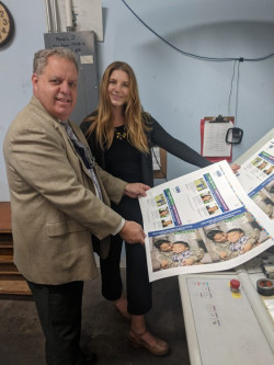 Reviewing a campaign mailer printed on a Heidelberg Speedmaster SM 74 at AdMail Express are Brian M. Schott, president and CEO, and Jordi Oliver, a recent graduate of Cal Poly's graphic communications program who works for Schott (another Cal Poly alumnus) in sales and marketing.
