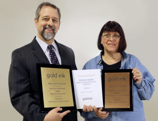 Copresco President Steve Johnson and Production Manager Lynn Buck show off the company's Gold Ink Awards for printing excellence.