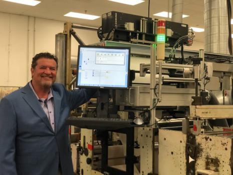 John Abbott of Abbott Label with the Domino K600i dual bar digital UV inkjet printer.