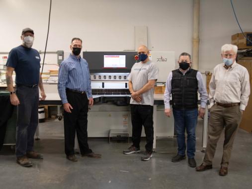 From left: Paul Shaver, Heidelberg service technician; Tom Cummings, Heidelberg account manager; Mike Lima, Braintree Printing operator; Jose Tafur, Braintree Printing owner; Jim Corliss, Braintree Printing marketing manager.