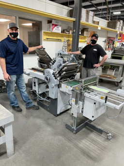 From left: Tony Collins, production manager, and Nick Larsen, bindery operator, both at Peczuh.