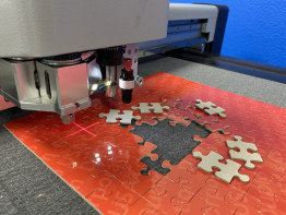 """The Duplo DC-600 digital diecutter can handle large media up to 23x31"""" and can cut, kiss cut, score, and perforate in one pass."""
