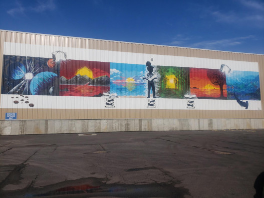 Worzalla worked with a local artist to commission a large mural for its facility expansion.