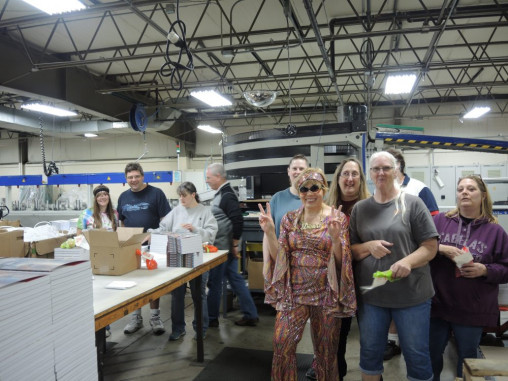 """Team members celebrate """"disco day"""" as a part of the book manufacturing specialist's 40th anniversary celebration."""