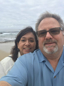 Brian Hite stands on the beach with his wife, Sharrie.
