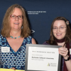 RSA's Marketing Director Elisha Kasinskas and Heather Warren, Web design and development programmer, accept one of the Pinnacle Awards at the ceremony in Rochester. (Photo by Kurt Brownell Photography)