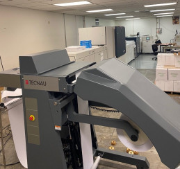 The new Xerox Baltoro HF cut-sheet inkjet press with in-line Technau SheetFeeder BV installed at the Washington State Department of Enterprise Services.