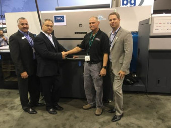 From left, Steve Powers, HP, Haim Levit, HP, Kevin Davis, president, Advanced Labels NW, Zak Callahan, HP with the HP Indigo 8000 at Labelexpo Americas.