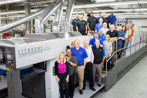 Salem-One with one of its Komori offset presses.